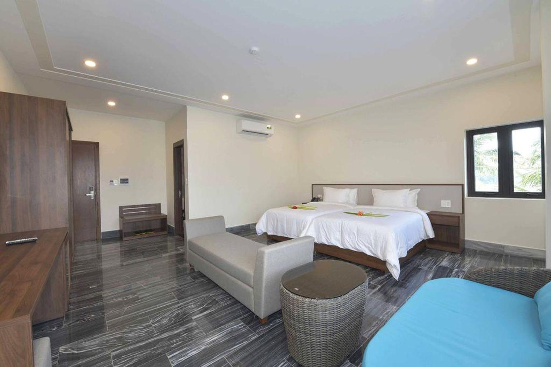 Phòng ngủ ở CocoLand River Beach Resort & Spa