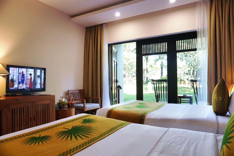 Phòng ngủ ở Khách sạn The Palm Garden Beach