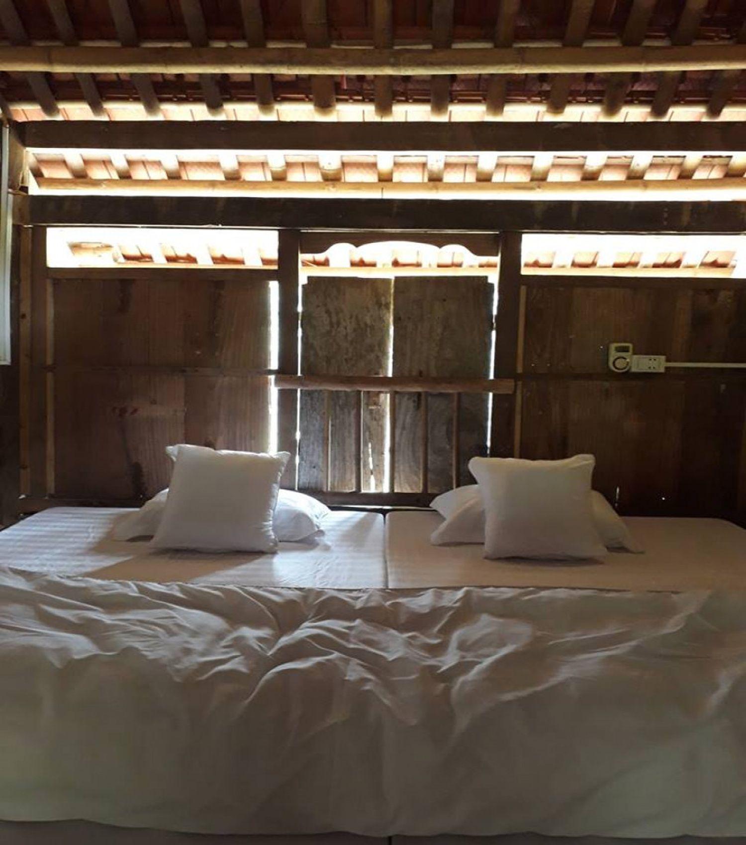 Phòng ngủ ở Mường Bi Homestay