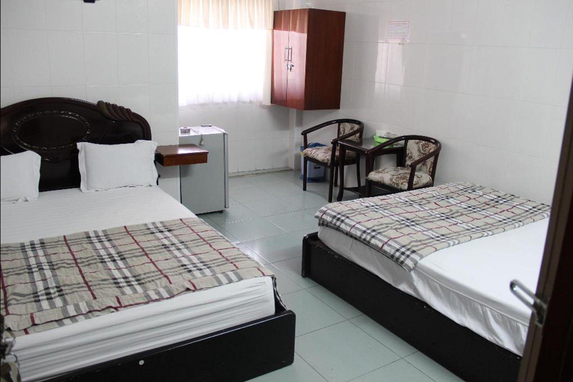 Phòng ngủ Nhà Nghỉ Phong Nha
